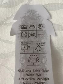 Etiket van de bol wol